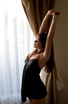 Free Beautiful Woman Stretching By Window Stock Image - 19403091