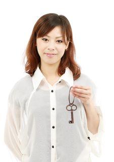 Free Beautiful Woman Holding A Key Stock Photo - 19405720