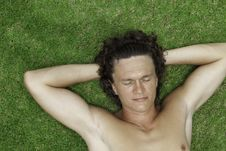 The Man Lies On A Green Grass Stock Photography