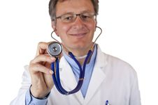 Free Closeup Of A Smiling Doctor Holding A Stethoscope Stock Images - 19407544