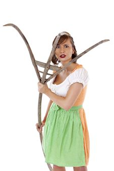 Free Young Bavarian Woman Attacks With Pitchfork Stock Image - 19407551