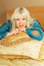 Free Blond Woman Sitting  With Pillows On A Bed Royalty Free Stock Photo - 19415025