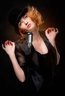 Free Stylish Redhead Singer Royalty Free Stock Image - 19412006