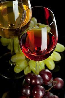 Red And White Wine In Glasses With Grape Royalty Free Stock Photos