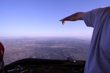 Man Points Towards The Horizon In Hot Air Balloon