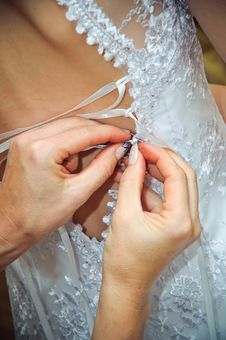 Free Hands Helping To Put On A Wedding Dress Royalty Free Stock Image - 19413046