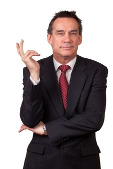 Free Smiling Business Man In Suit Gesturing With Hand Royalty Free Stock Photos - 19414148