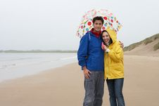 Free Young Couple On Beach With Umbrella Royalty Free Stock Photography - 19419247