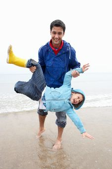 Happy Father With Son On Beach Stock Photo