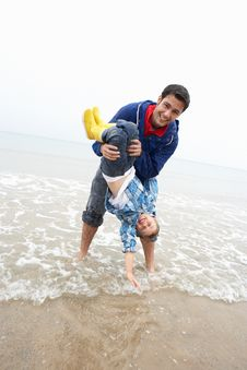 Happy Father With Son On Beach Stock Images