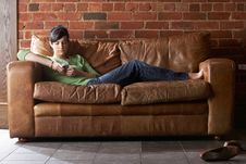 Free Young Woman With Phone On Sofa Stock Photography - 19422612