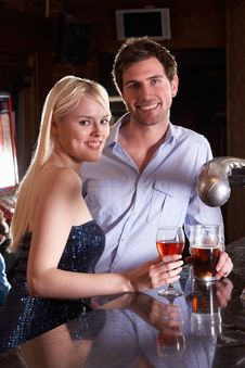 Free Young Couple At Bar Stock Photography - 19422852