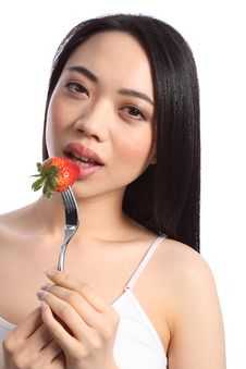 Sexy Chinese Teenager Eats Fresh Strawberry Fruit Royalty Free Stock Image