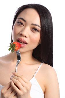 Free Sexy Chinese Teenager Eats Fresh Strawberry Fruit Royalty Free Stock Image - 19426306