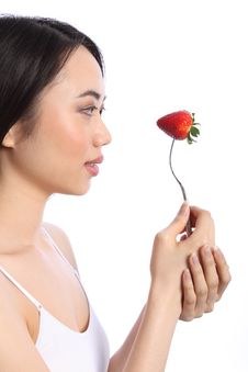 Pretty Chinese Teenager Girl And Strawberry Fruit Royalty Free Stock Photo