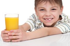 Free Boy With A Glass Of Juice Royalty Free Stock Photos - 19431338
