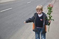 Free A Boy With Flowers Stops The Car Royalty Free Stock Image - 19435506