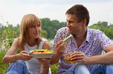 Young Happy Couple Eating Together Outdoors Royalty Free Stock Photo