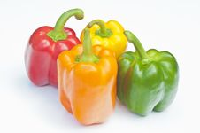 Four Different Coloured Peppers Royalty Free Stock Photo