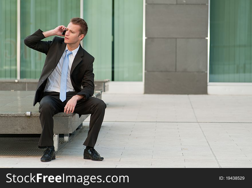 Young business man with a telephone