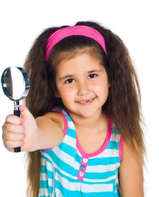 Little Girl Looking Through A Magnifier Stock Photography