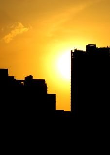 Free Summer Sunset With Silhouette Of Buildings Stock Photos - 19441633
