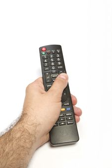 Male Hand Holding Remote Control Royalty Free Stock Photography