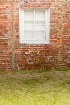 Brick Wall With White Window Stock Image