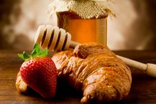 Free Croissants With Honey And Strawberries Stock Images - 19444414