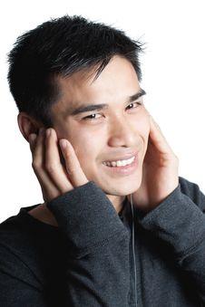 Free Man Listening On Earbud Headphones Royalty Free Stock Photos - 19446968