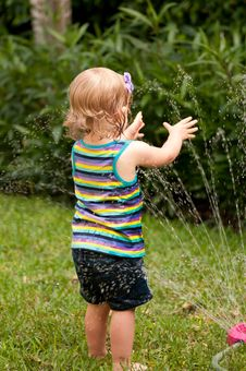 Free Girl Playing In Water Stock Photos - 19447593