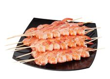 Free Skewers Of Shrimp On A Black Plate Royalty Free Stock Photos - 19449318