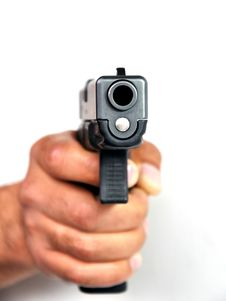 Free Pistol In A Man S Hand On A White Background. Royalty Free Stock Photos - 19449628