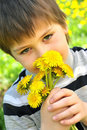 Free A Boy With A  Dandelions Royalty Free Stock Image - 19455226