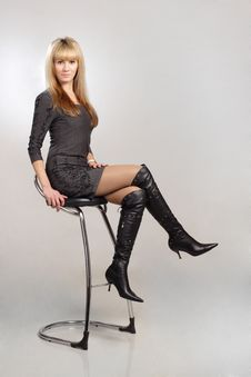 Free Beautiful Blond Sexy Woman Sitting On Chair Royalty Free Stock Photos - 19450928
