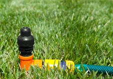 Lawn With Sprinkler Royalty Free Stock Photography