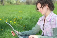 Free Girl With  Laptop On The Spring Meadow Stock Photo - 19453210