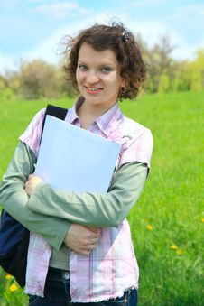 Female Teenage Student In Summer Park Stock Image