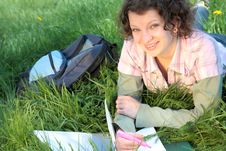 Girl Student In Park Writes  Writing Book Royalty Free Stock Photography