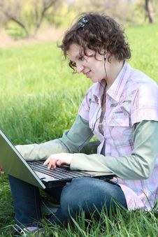 Free Girl With  Laptop On The Spring Meadow Royalty Free Stock Images - 19453249