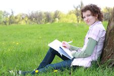 Free Girl Student In Park Writes  Writing Book Royalty Free Stock Photo - 19453265