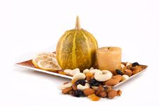 Free Pumpkin With Candle Lemon And Nuts On The Plate Stock Photography - 19457182