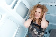 Free Pretty Young Woman In Cargo Van Inside Royalty Free Stock Images - 19457379