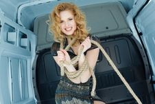 Pretty Young Woman In Ropes In Cargo Van Stock Photos