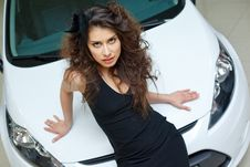 Free Young Woman On White Hood Of New Car Stock Photography - 19457662