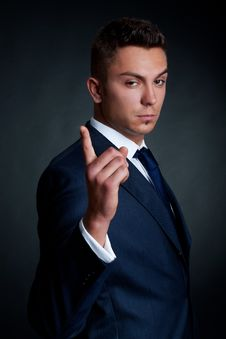 Man In Elegant Suit Pointing The Finger Royalty Free Stock Photos