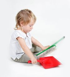 Free Child With Dustpan And Brush Royalty Free Stock Photos - 19464198