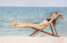 Free Happy Woman Relaxing On Beach Stock Photography - 19464282