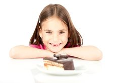 Little Girl With Chocolate Cake Royalty Free Stock Photos