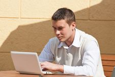 Free Man Using A Laptop Outdoors Royalty Free Stock Photography - 19467107